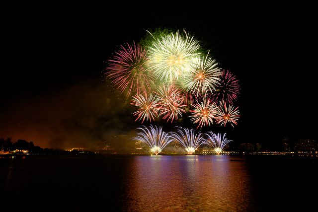 Fireworks light up the night sky in Singapore on 27 June 2014 to